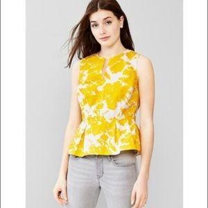 Bright, chic yellow peplum top